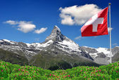 Matterhorn with Swiss flag — Stock Photo