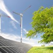 Solar energy panels and wind turbine - Foto Stock
