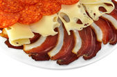 Prosciutto ham with cheese — Stock Photo