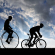 Silhouette cyclists — Stock Photo