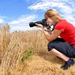Girl taking photos — Stock Photo
