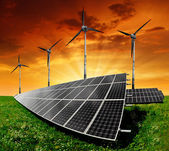 Solar panels and wind turbine — Stock Photo