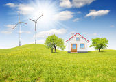 House with wind turbines — Stock Photo