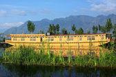 House Boath on the mauntains lake — Stock Photo