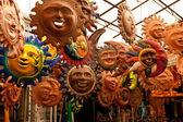 A lot of beautiful handmade masks of sun — Stock Photo