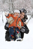 Young mam and her son in the snow — Stock Photo