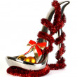 Shoe made from metal with cristmas toys — Stock Photo