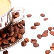 Metal Cup of espresso coffee with spoon and seeds - Stock Photo