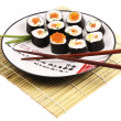 Stock Photo: Sushi rolls on white plate