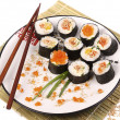 Sushi rolls on a white plate — Stock Photo