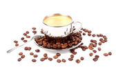 Metal Cup of espresso coffee with spoon and seeds — Stock Photo