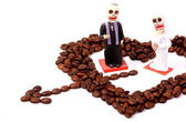 Heart from brown coffee beans with little toys — Stock Photo