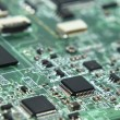 Green laptop motherboard in macro — Stock Photo