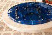 Blue round jacuzzi — Stock Photo