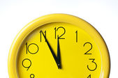 Yellow clock on a white background — Stock Photo