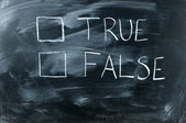 True Or false on black chalkboard,white handwriting on blackboar — Photo