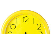 Yellow clock on a white background,place for your own text, picture — Stok fotoğraf