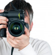 Young man with camera, isolated on white background, focus is on — Stock Photo