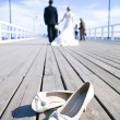 Wedding couple walking at the bridge — Stock Photo #9138941