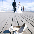 Wedding couple walking at the bridge - Stock Photo