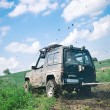 Offroad through muddy field — Stockfoto #9139751