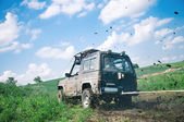 Offroad through muddy field — Stock fotografie