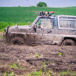 Offroad through muddy field — Stock Photo