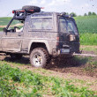 Offroad through muddy field - Lizenzfreies Foto
