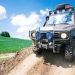 Stok fotoğraf: Offroad through muddy field