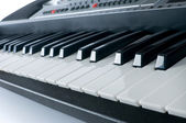 Synthesiser piano keyboard on white background — Stock Photo