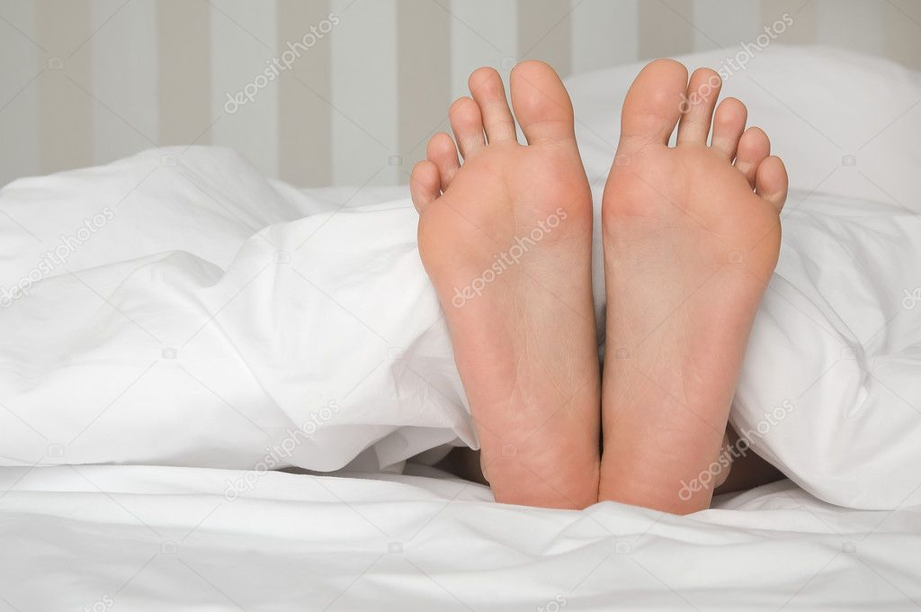bare foot in bed