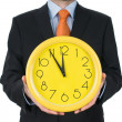 Stok fotoğraf: Businessmhand holding clock isolated on white background