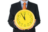 Main d'homme d'affaires sur l'horloge isolé sur fond blanc — Photo