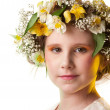 Stock Photo: Portrait of a beautiful girl wearing flowers hat.