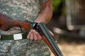 The hunter charges a shot-gun, a close up — Stock Photo