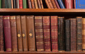Antique books on shelf — Stock Photo