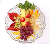 Dish with fruits and berries — Stock Photo