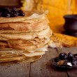 Stock Photo: Crepes on wooden table with cherry