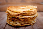 Crepes on the wooden table — Stock Photo