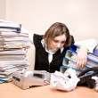 Young businesswoman with tons of documents — Stock Photo #7976624
