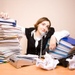 Young businesswoman with tons of documents — Stock Photo #7976629