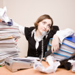 Young businesswoman with tons of documents — Stock Photo #7976634