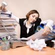 Young businesswoman with tons of documents — Stock Photo #7976656