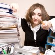 Tired businesswoman with a lot of folders - Stockfoto