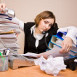 Young businesswomwith tons of documents — Stock Photo #7976668