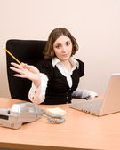 Young businesswoman working at the office — Stock Photo
