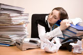 Young secretary with a lot of folders — Stock Photo