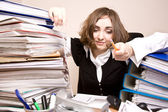 Tired businesswoman with a lot of folders — Stock Photo