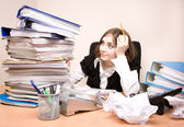 Secretary with a lot of documents — Stock Photo