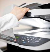 Woman's hand with copier — Stock Photo